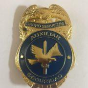 Placa de auxiliar de seguridad del grupo servicum
