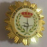 Placa del Colegio Oficial de Licenciados en Ciencias de la Actividad Física y el Deporte