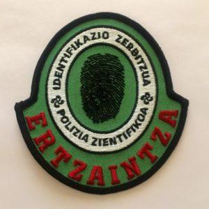 escudo bordado de la policía científica de la ertzaintza